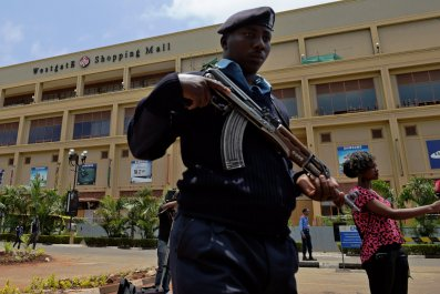 Kenyan police patrol outside Westgate