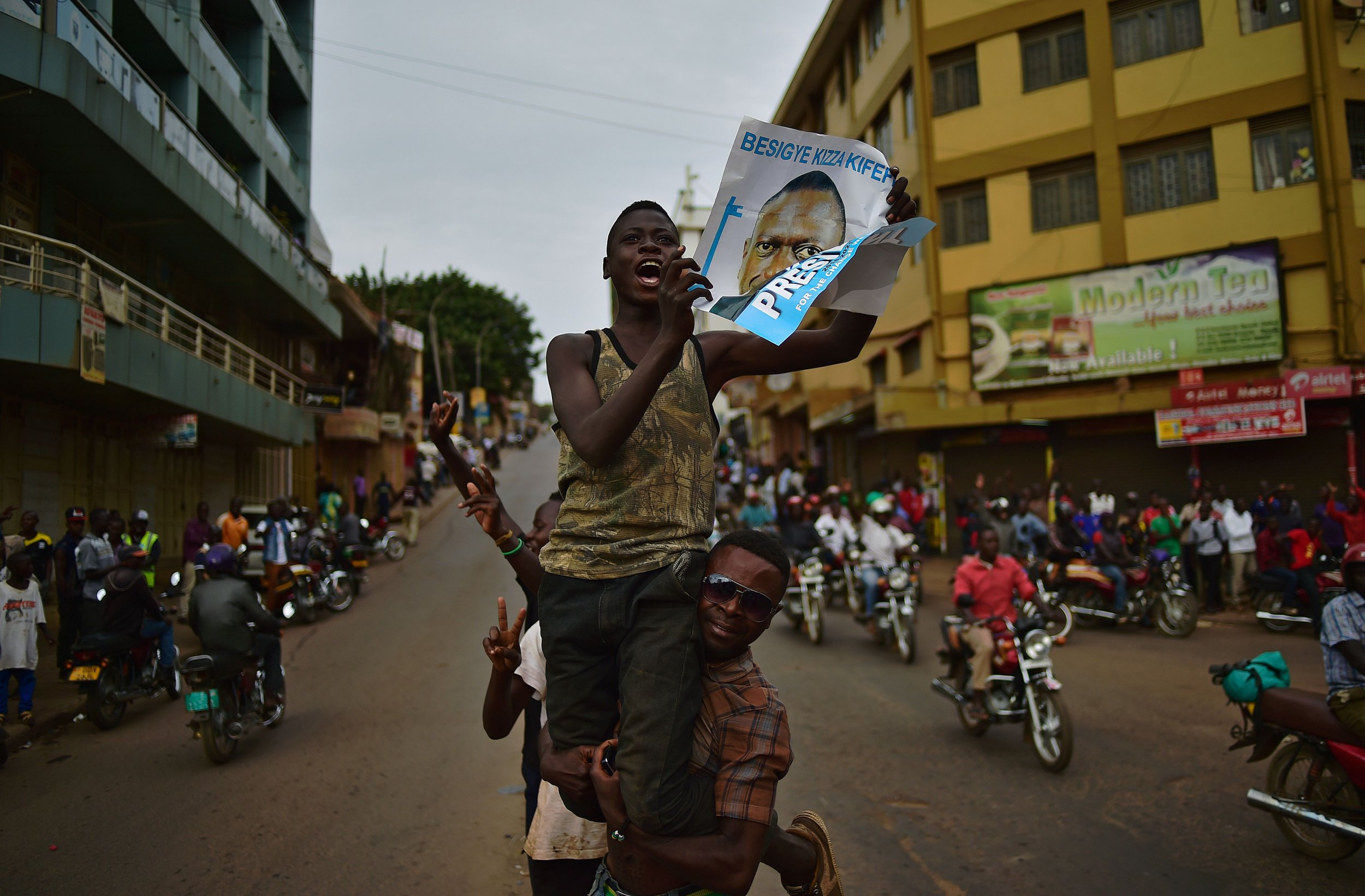 Kizza Besigye supporters cheer in Kampala.