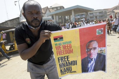 Pro-Biafra activist with Nnamdi Kanu poster.