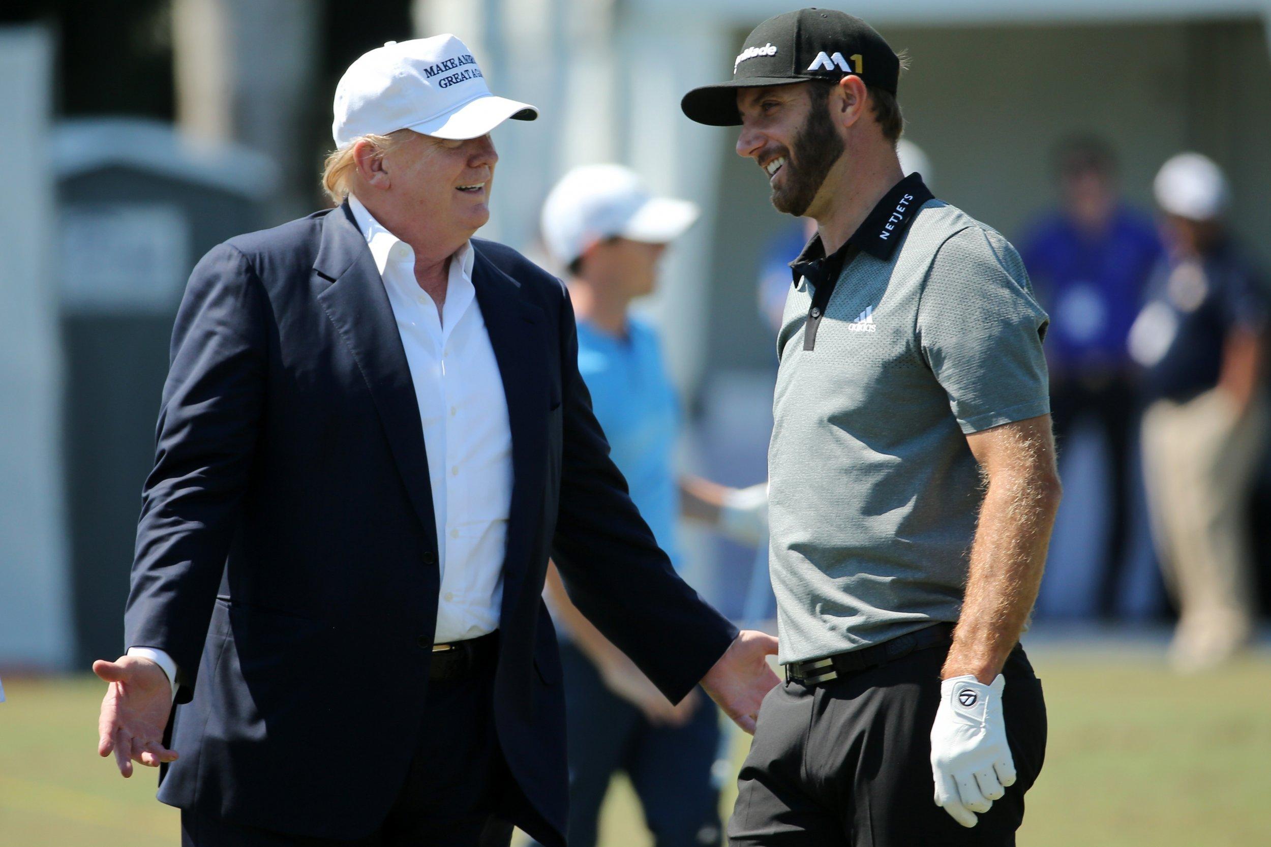 Donald Trump, left, with golfer Dustin Johnson.