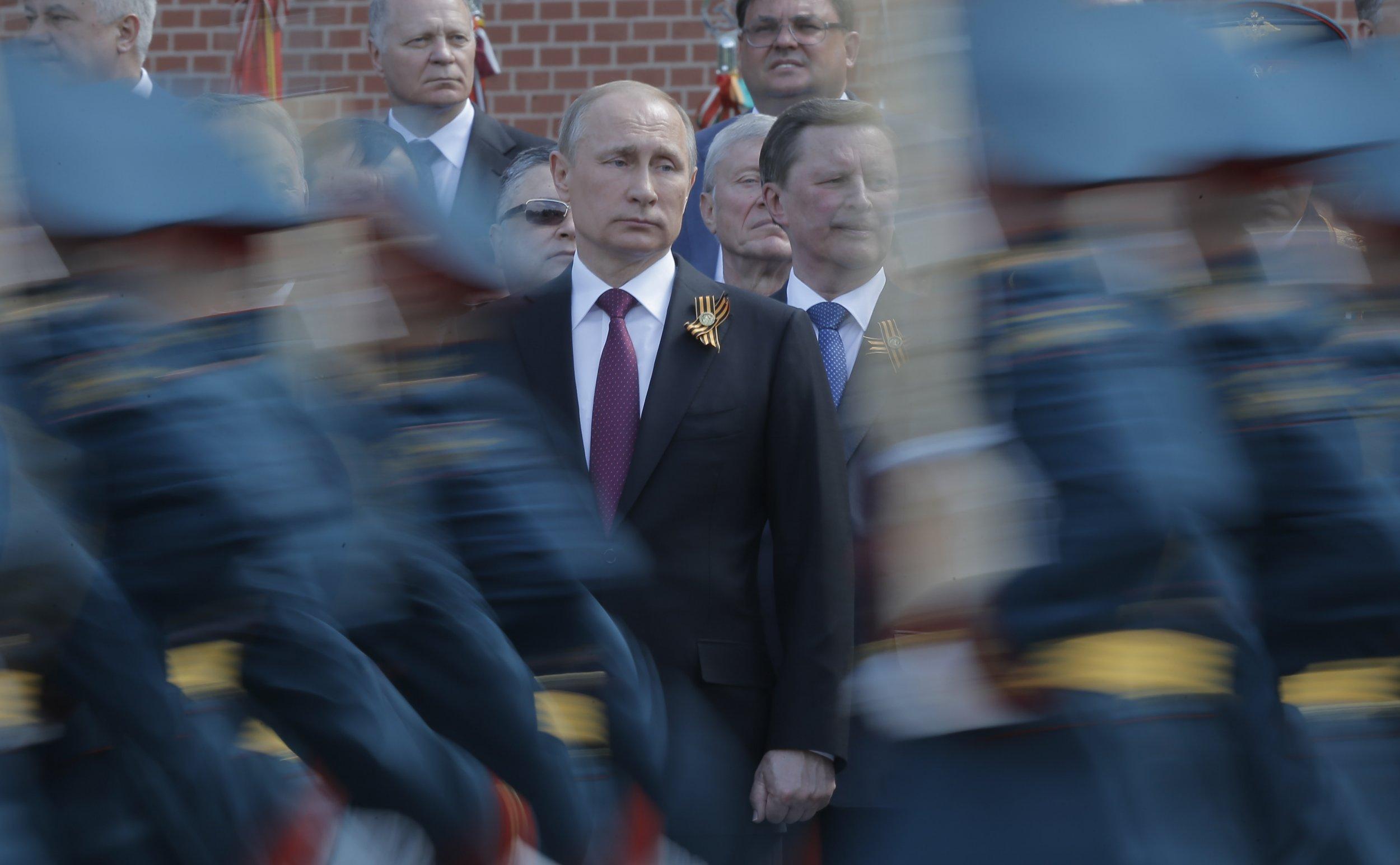 Vladimir Putin and Russian troops