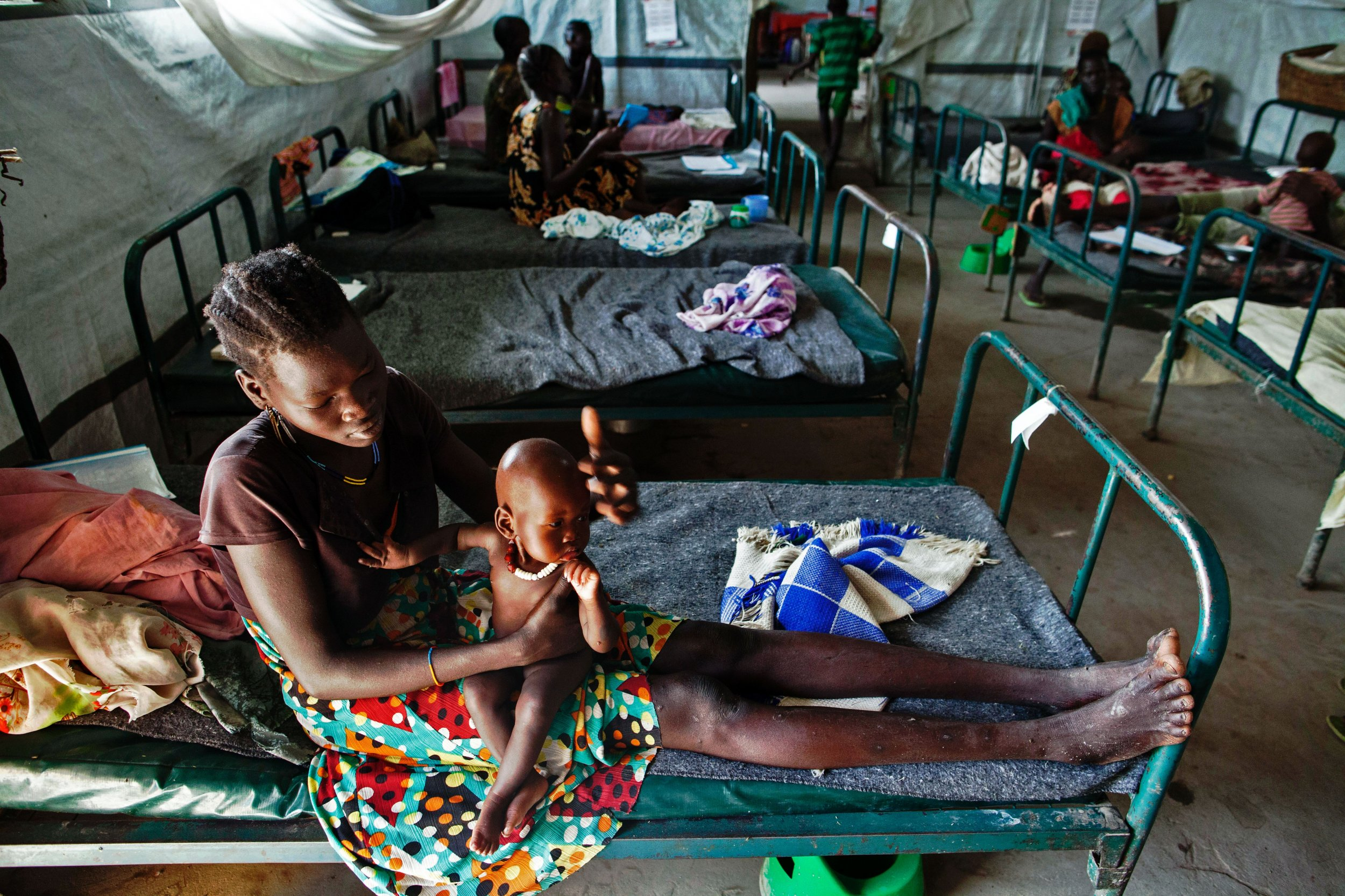 South Sudanese woman with malnourished child.