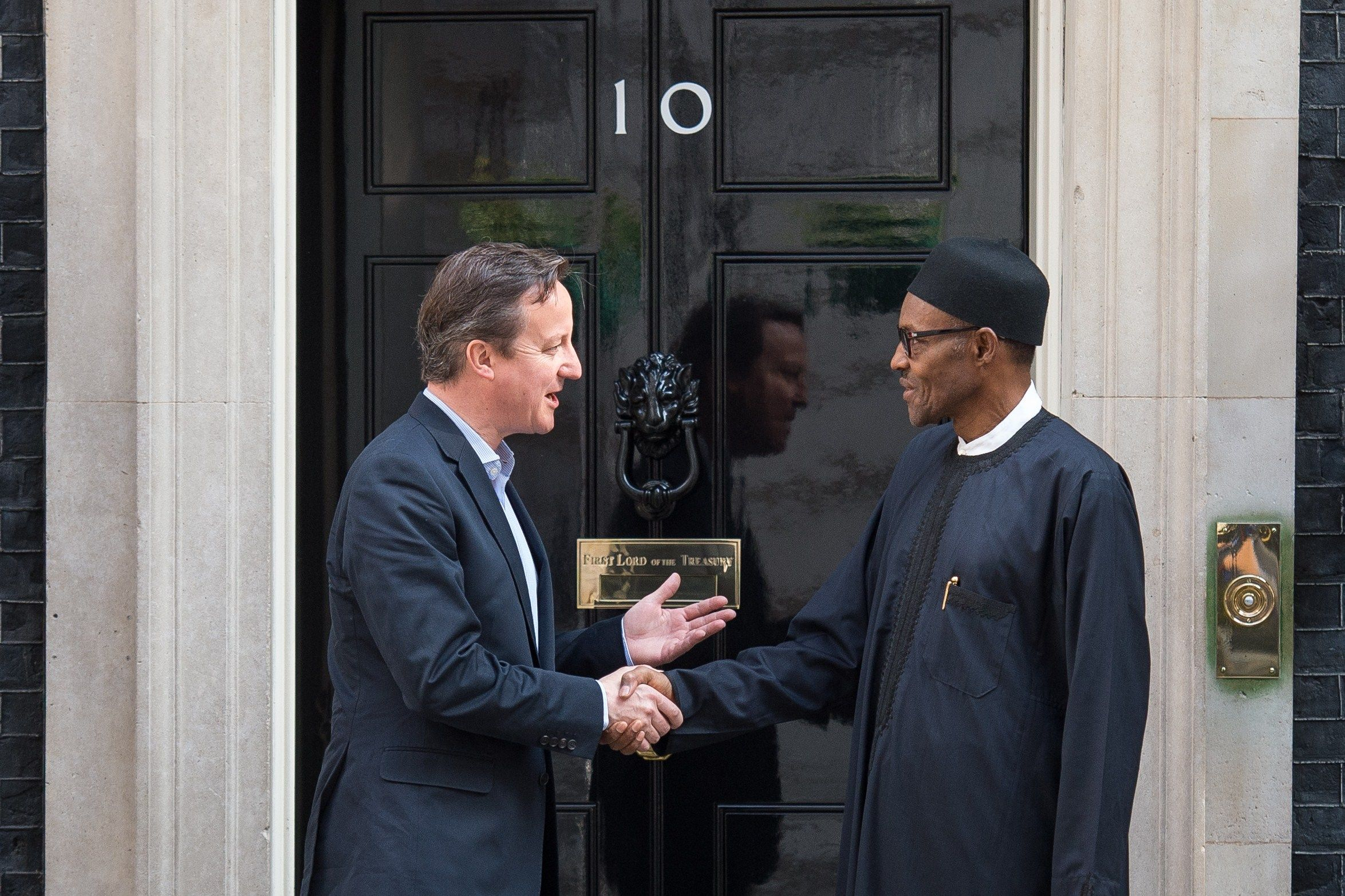 Muhammadu Buhari shakes hands with David Cameron