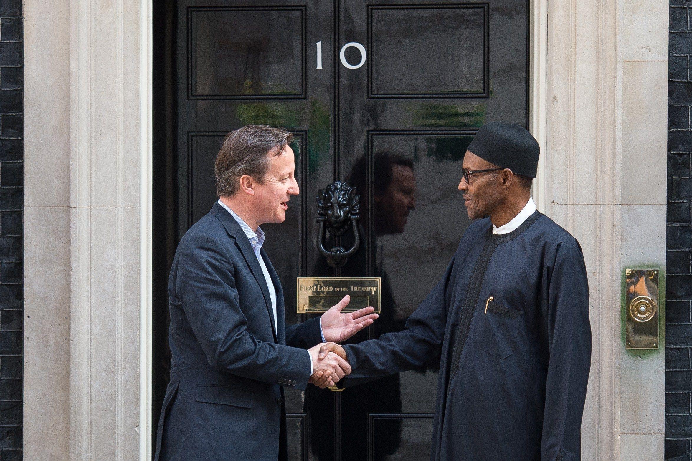 Muhammadu Buhari shakes hands with David Cameron