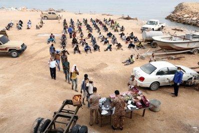 Migrants receive food in Libya