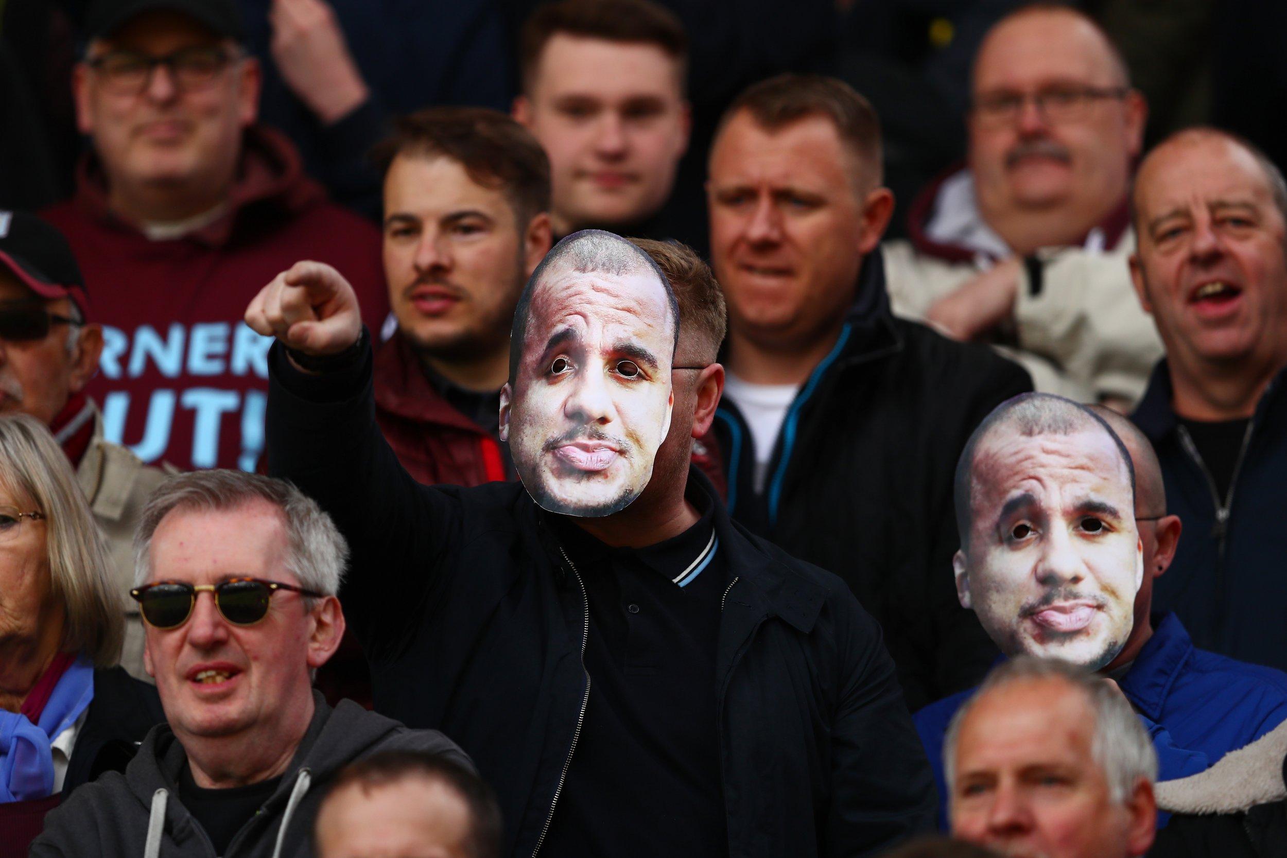 Aston Villa fans wearing Gabriel Agbonlahor masks.