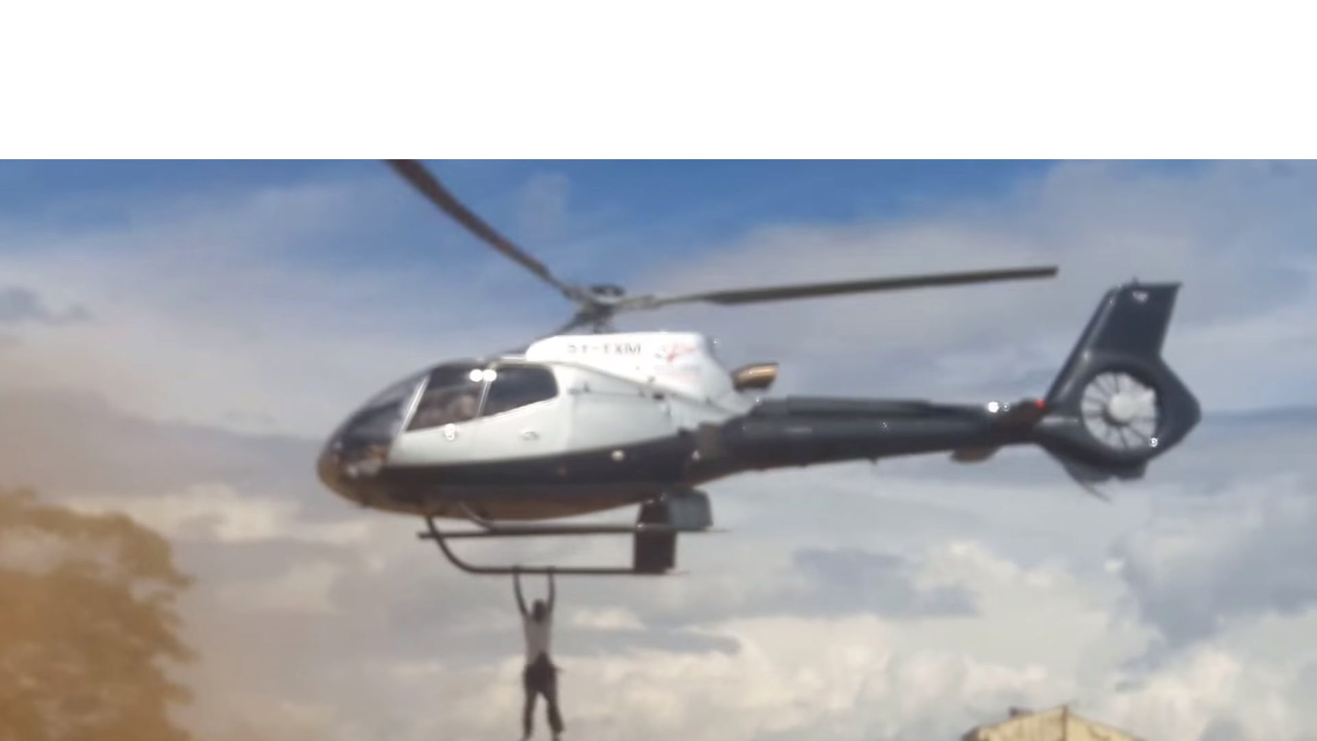 Jacob Juma mourner clings to helicopter