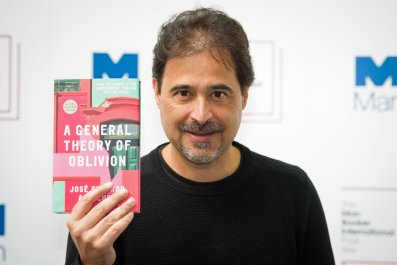 José Eduardo Agualusa and his award-nominated book.