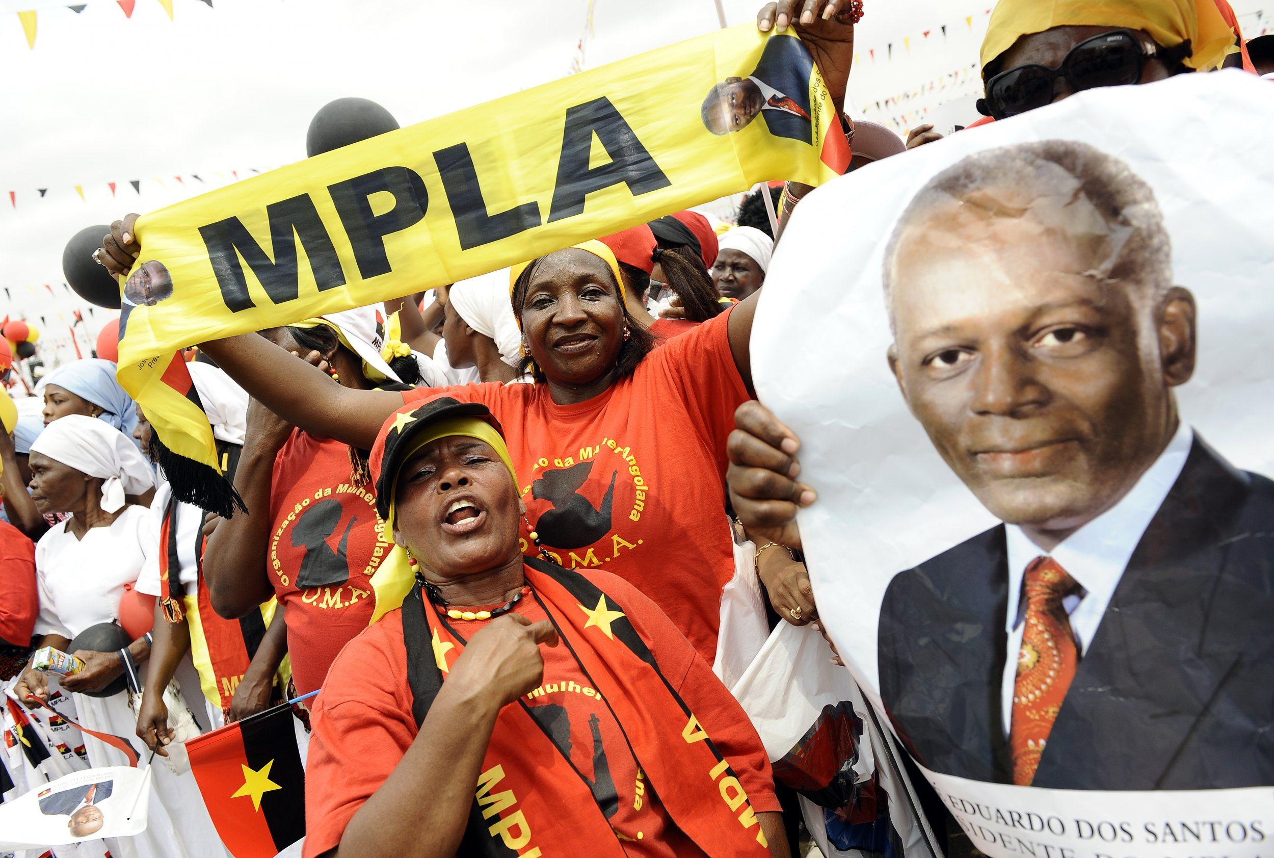 MPLA supporters with President dos Santos flag.