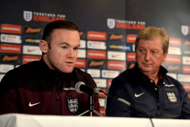 Wayne Rooney, left, with England coach Roy Hodgson.