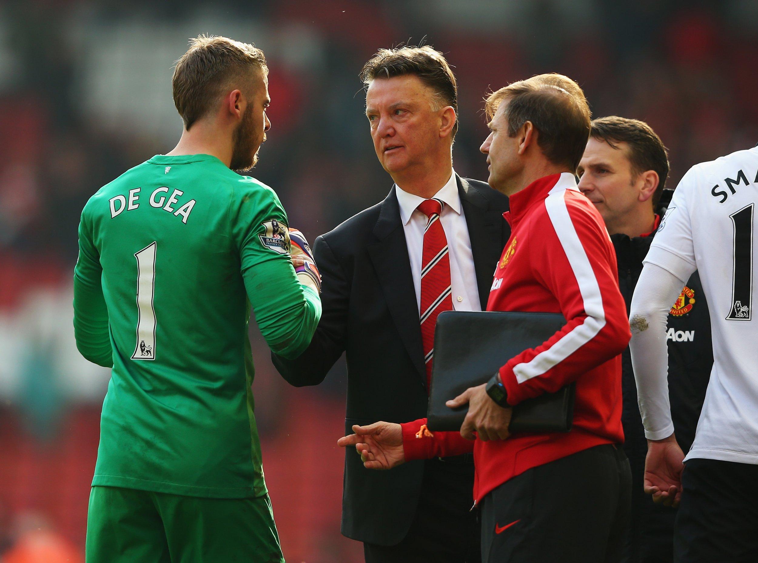 Manchester United goalkeeper David De Gea, left, and manager Louis Van Gaal, centre.