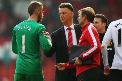 Manchester United goalkeeper David De Gea, left, and manager Louis Van Gaal, centre.