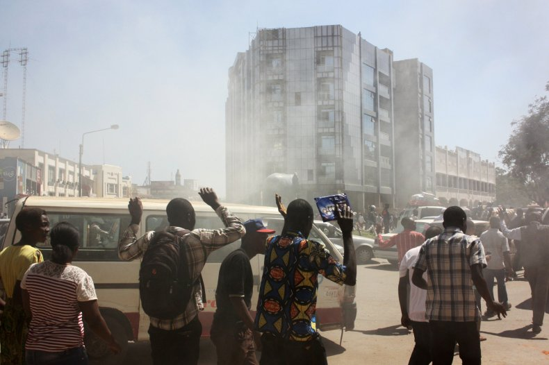 Moise Katumbi supporters flee after being teargassed.