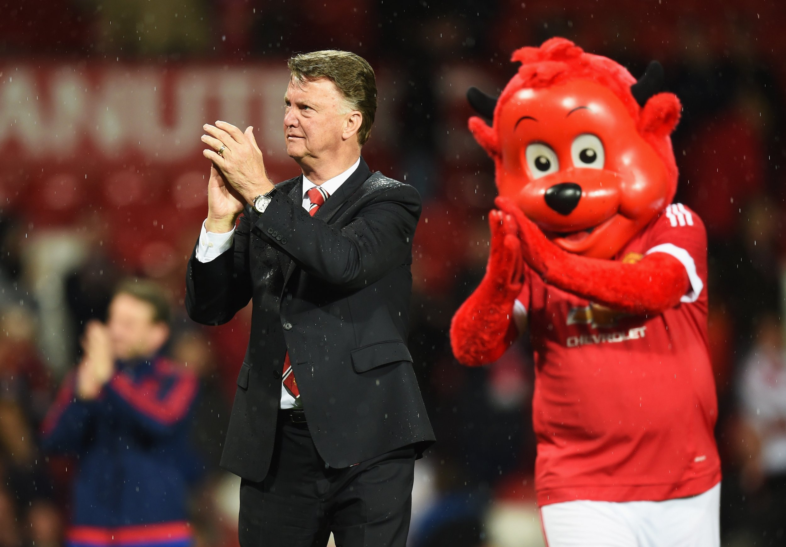 Manchester United manager Louis Van Gaal, left, with the club mascot Fred the Red.