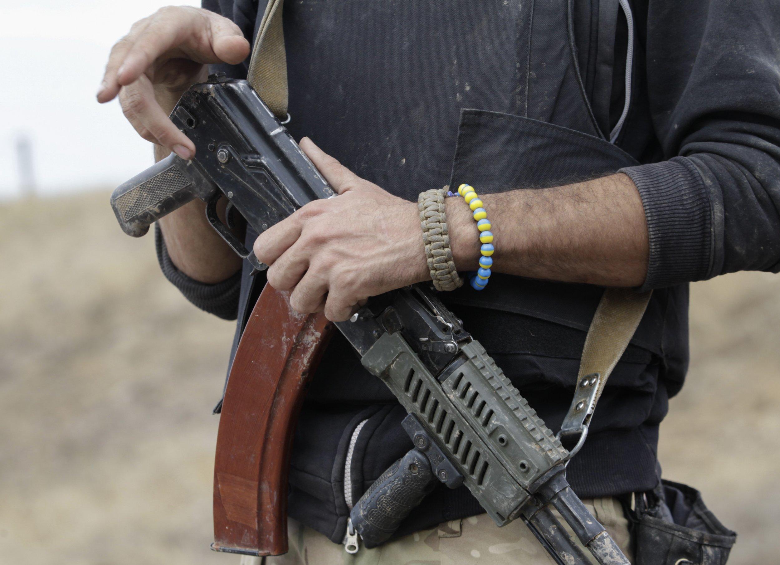 Ukrainian fighter holds a gun