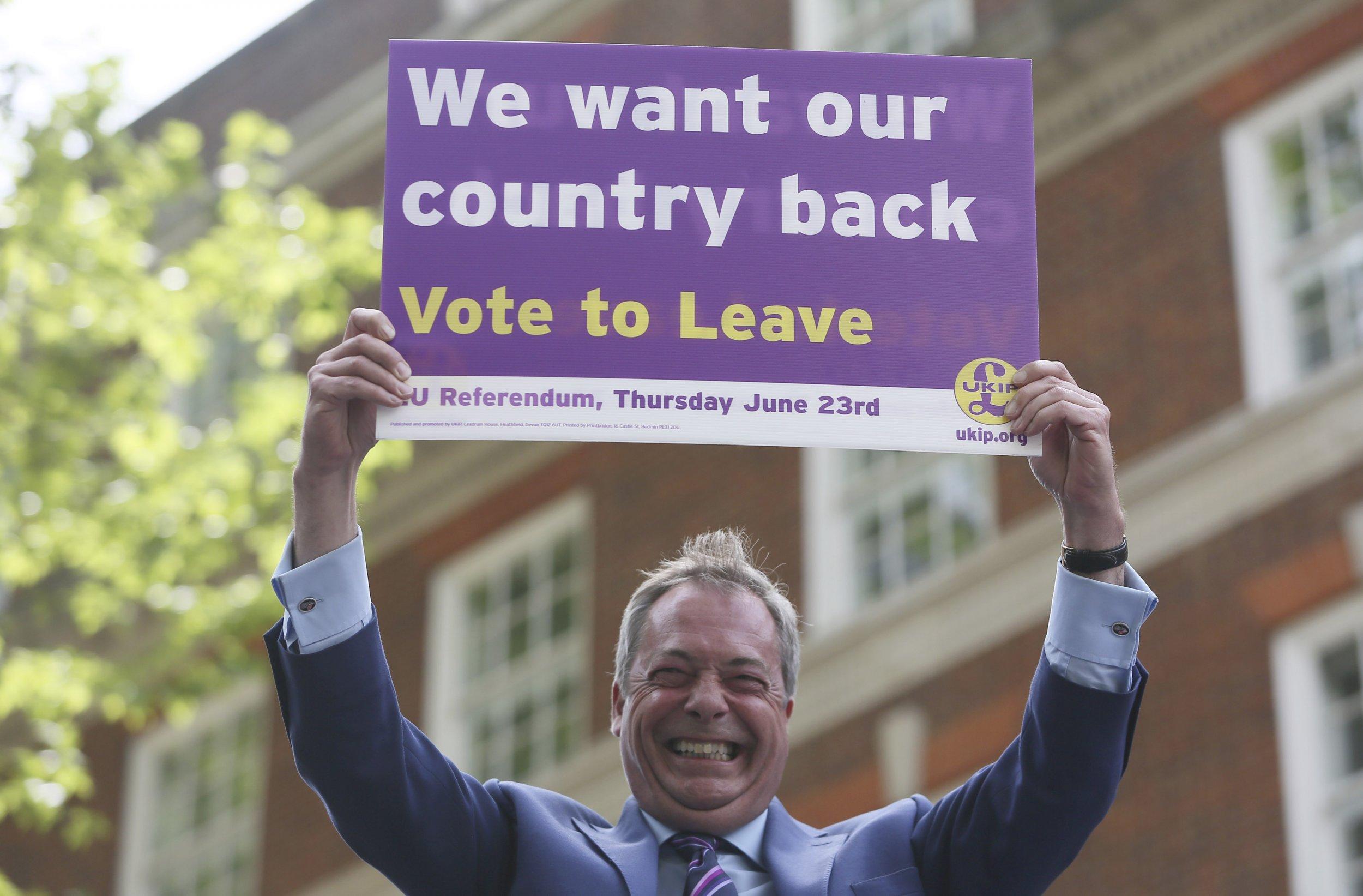 Nigel Farage holds Brexit sign