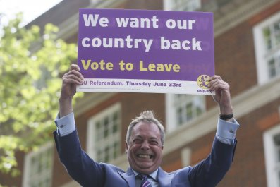 Nigel Farage holds Brexit sign