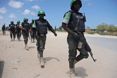 AMISOM soldiers patrol in Mogadishu