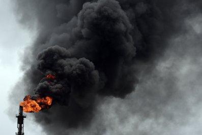 Smoke billows from Nigeria oil refinery.