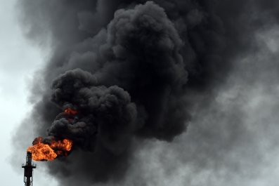 Smoke billows from Nigeria oil refinery.