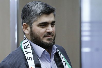 HNC negotiator Mohammed Alloush arrives in Geneva.