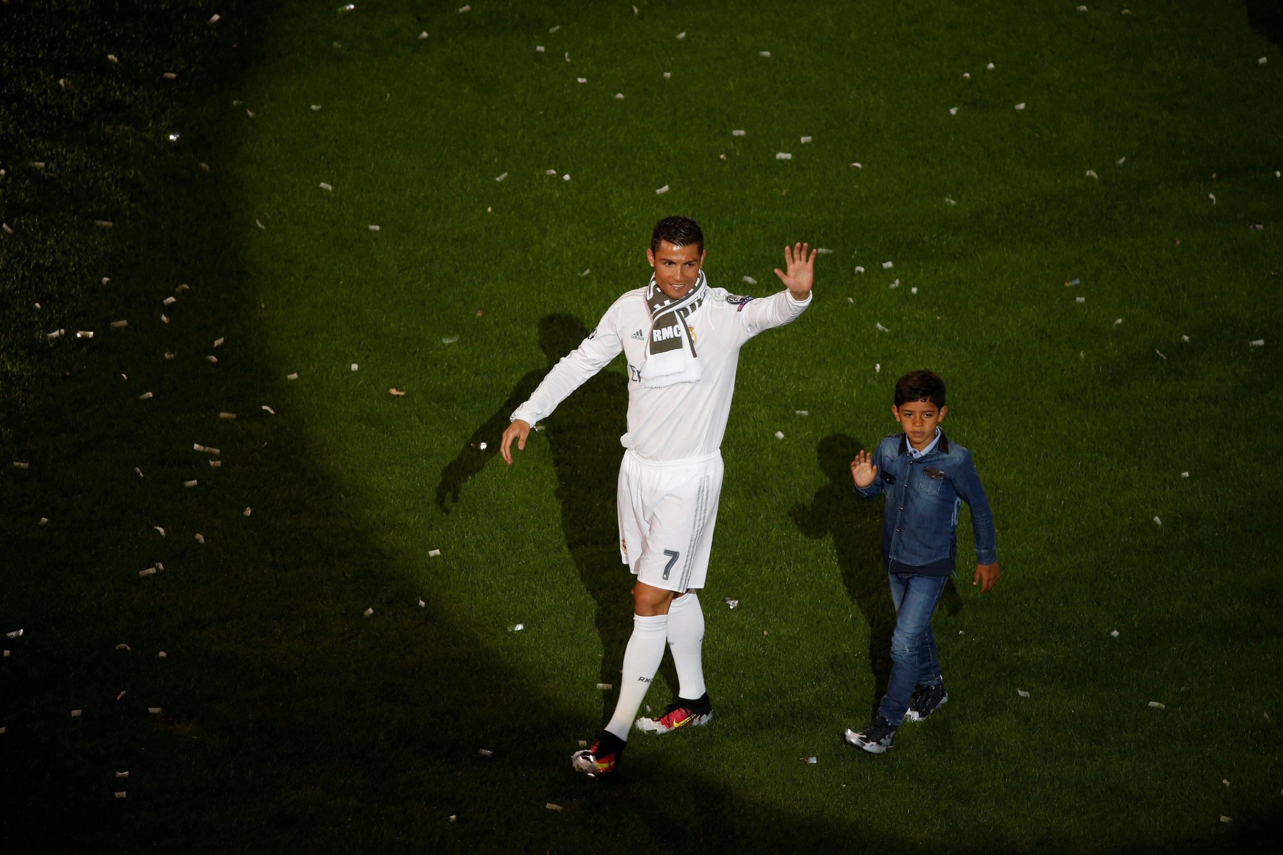 Cristiano Ronaldo celebrates with his son.