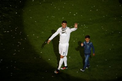Cristiano Ronaldo celebrates with his son.