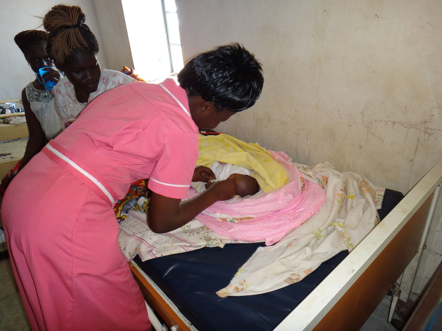 Midwife treats infant in South Sudan