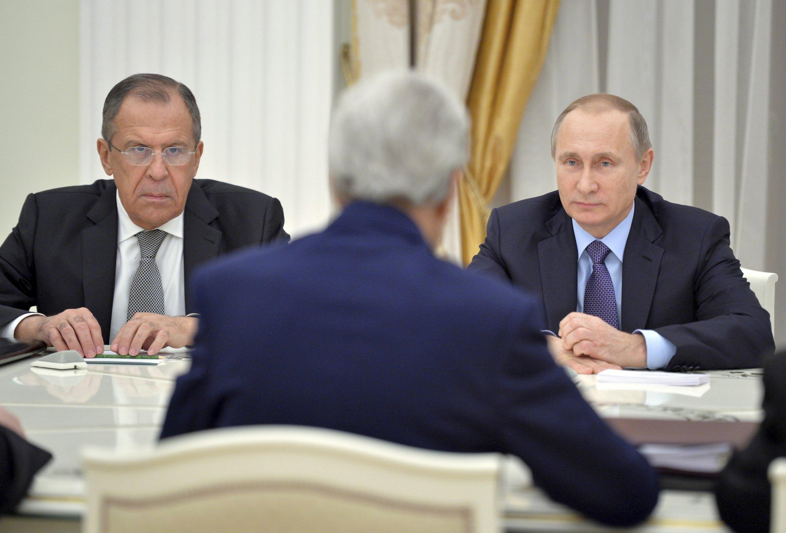 Sergei Lavrov and Vladimir Putin (R)