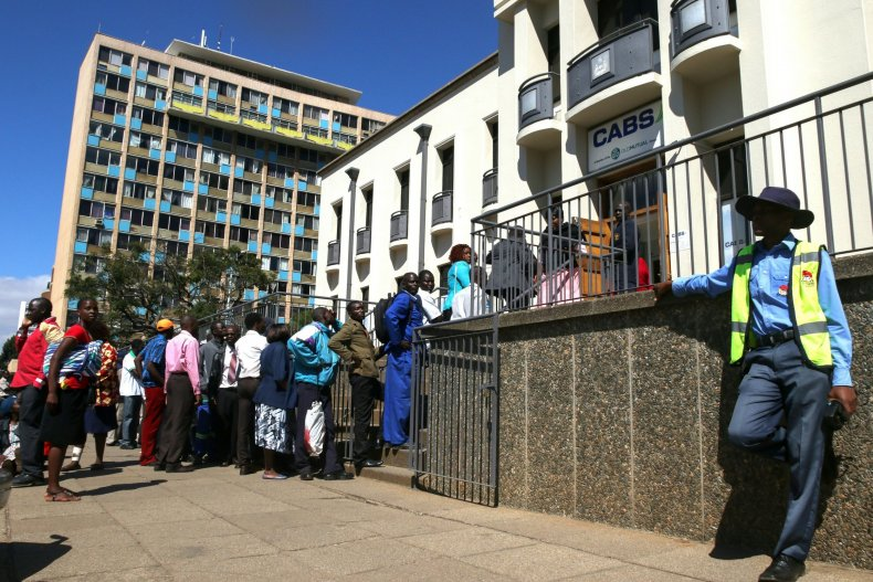 Zimbabweans queue for cash.