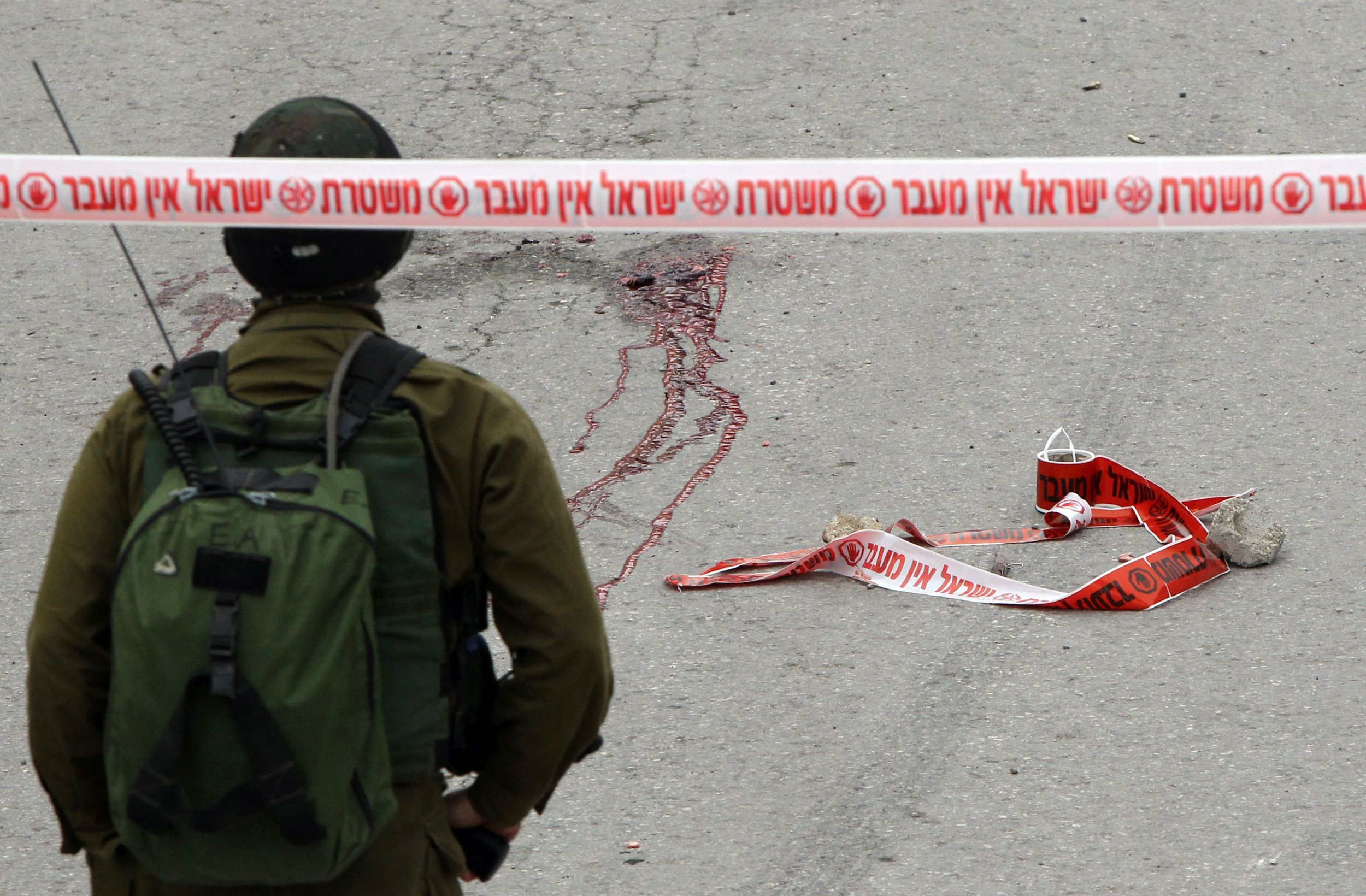 Israeli soldier at scene of a Hebron stabbing attack