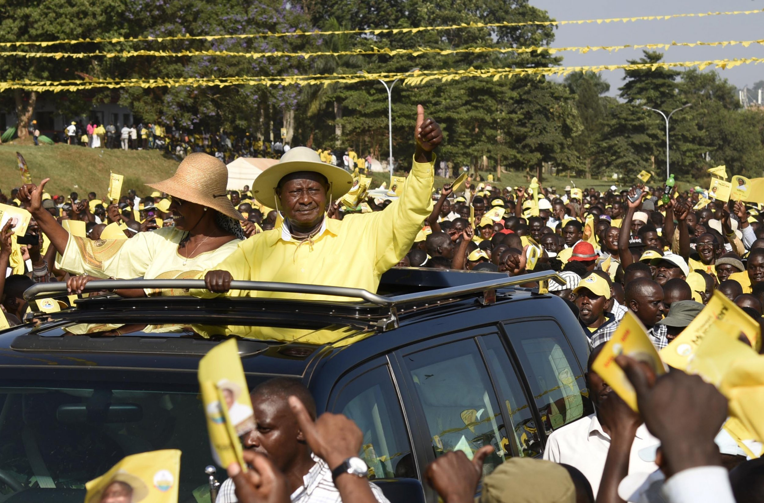 Yoweri and Janet Museveni wave to supporters.