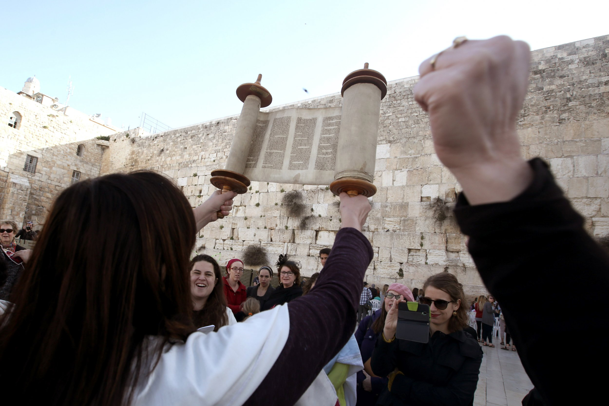 Women of the Wall hold up Torah at the Western Wall