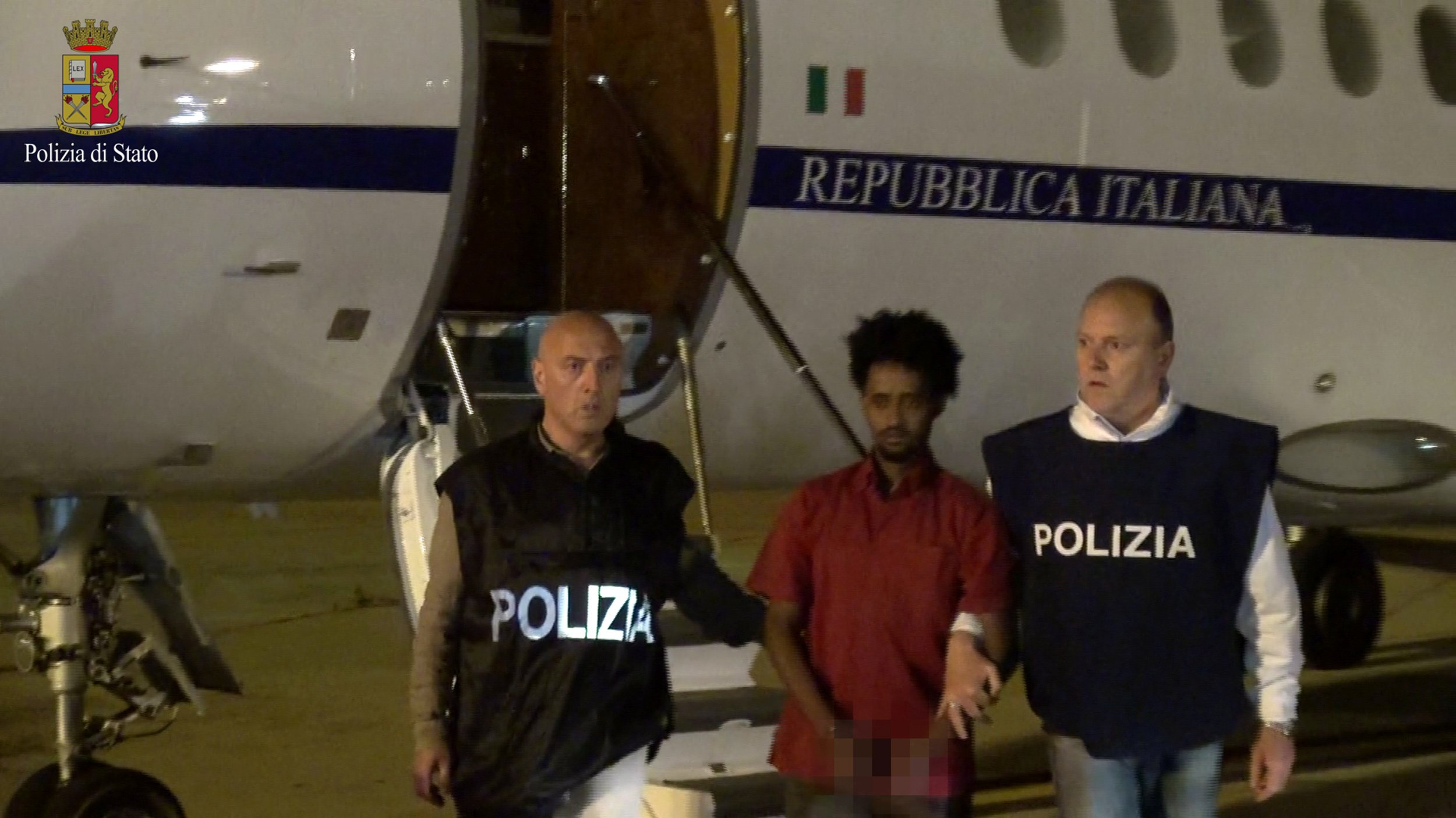 Italian police with smuggling suspect.