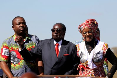 Robert and Grace Mugabe greet supporters