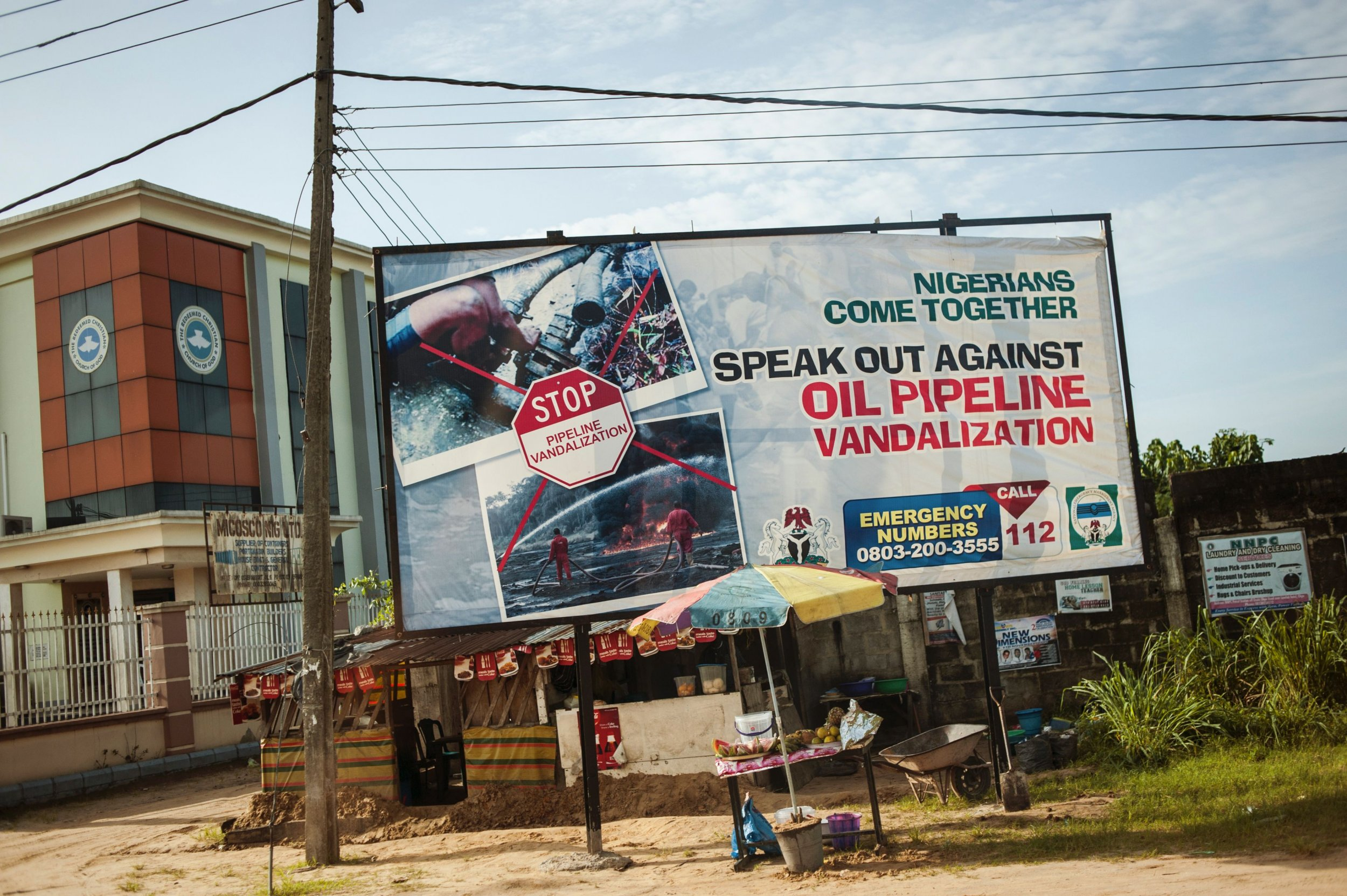 Niger Delta oil pipeline advertizing board