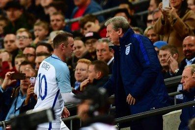 England captain Wayne Rooney, left, with Roy Hodgson.