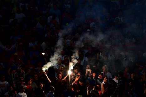 A Russian fan lights flares at Stade Velodrome.