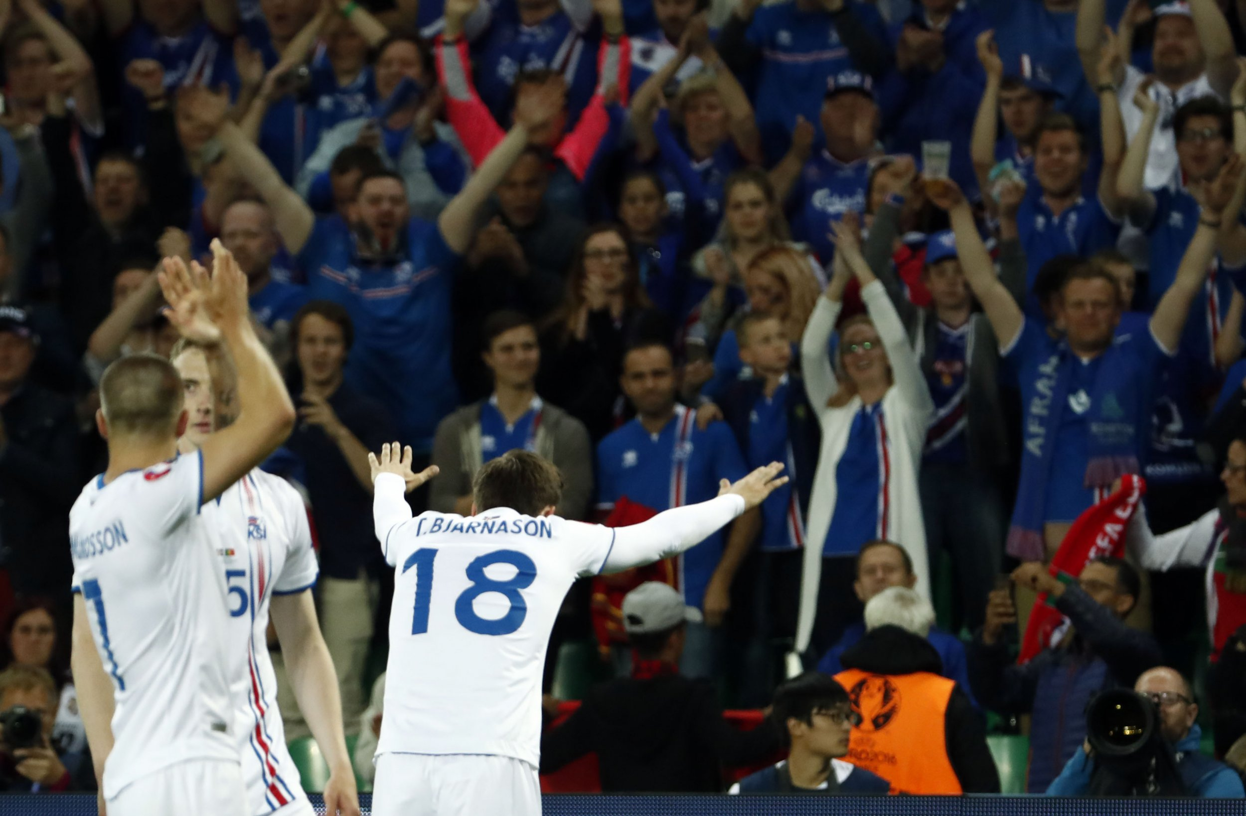 Iceland celebrates after its 1-1 draw with Portugal.