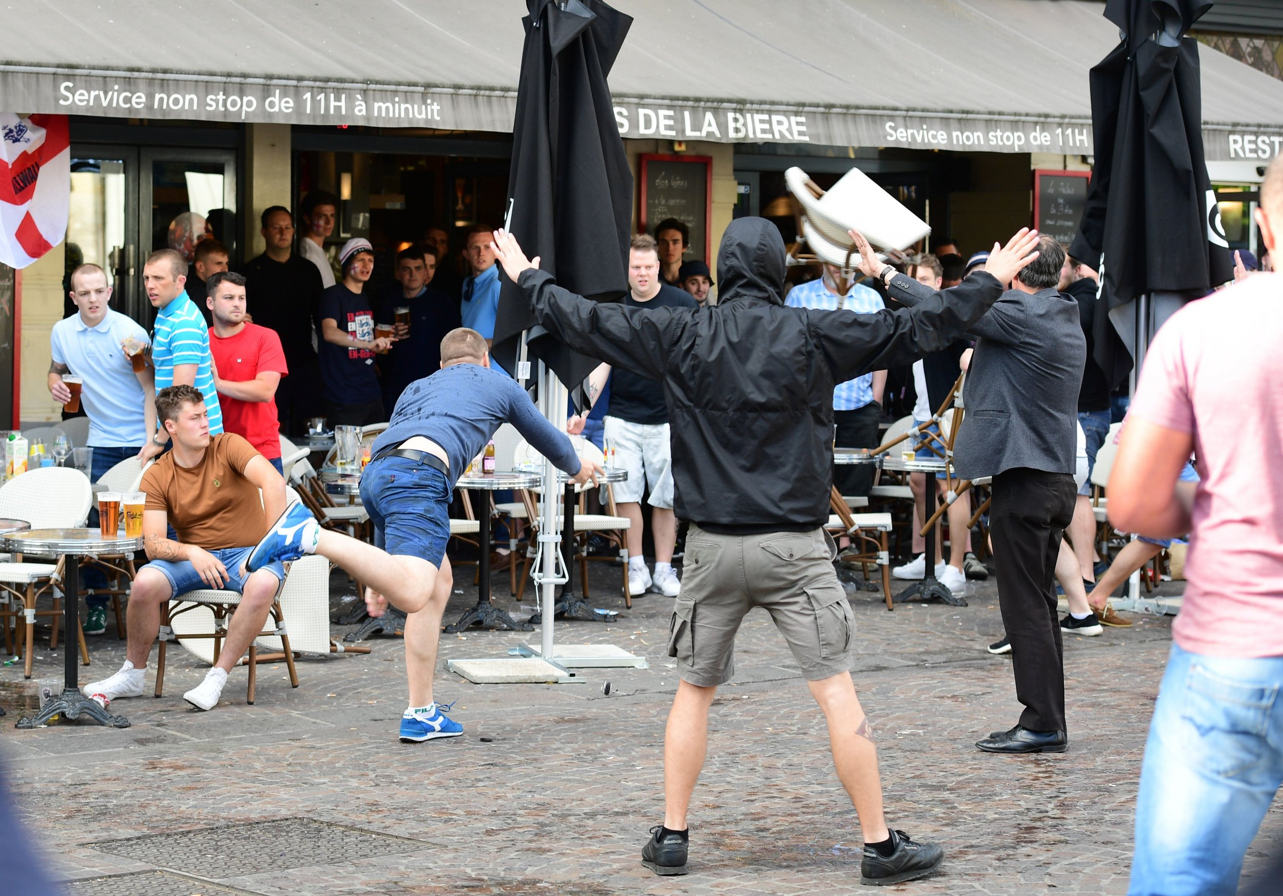 A Russia football supporter lobs a chair in Lille, France.