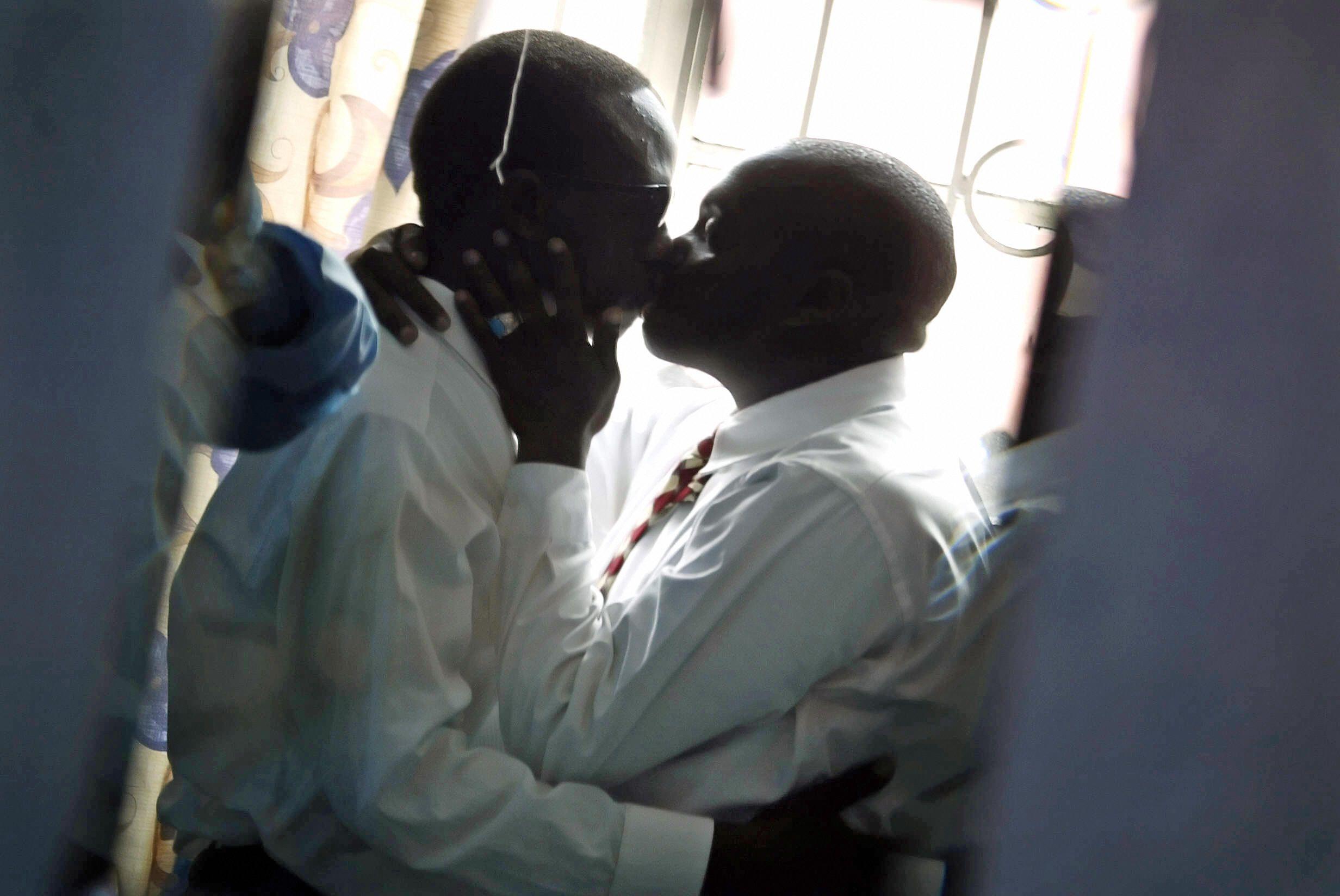 Gay men kiss in Nairobi.