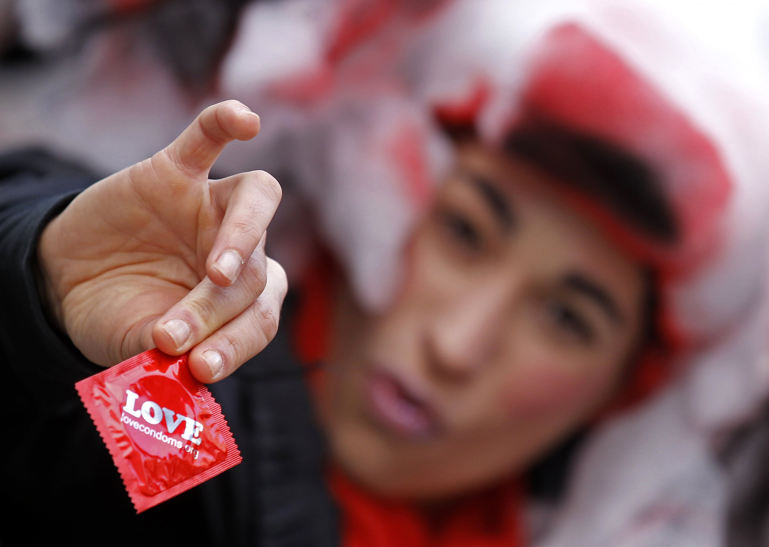 Circus performer holds condom