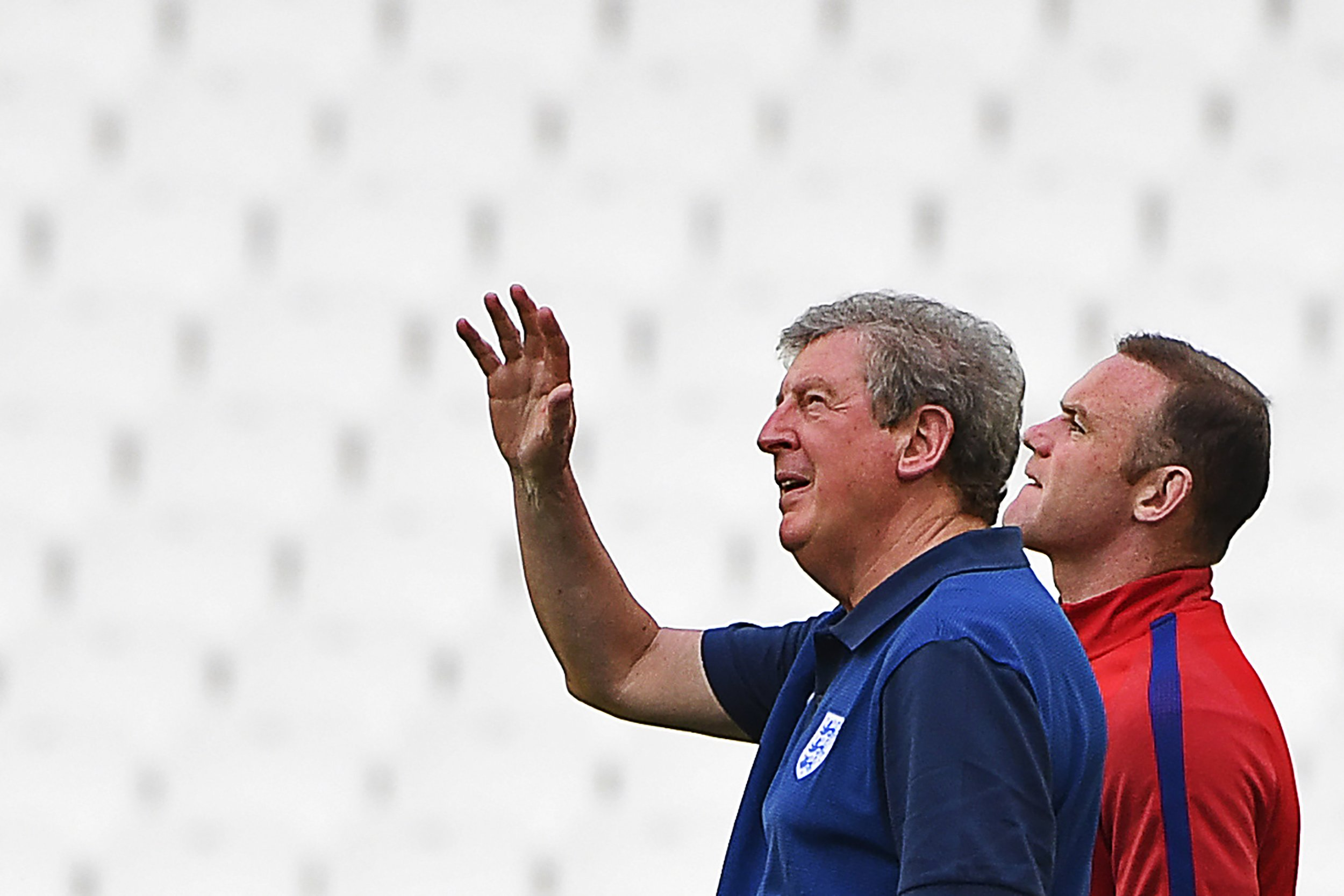 England coach Roy Hodgson (L) with captain Wayne Rooney