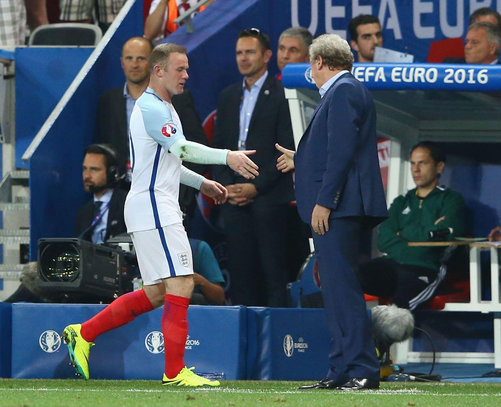 England captain Wayne Rooney, left, with former manager Roy Hodgson