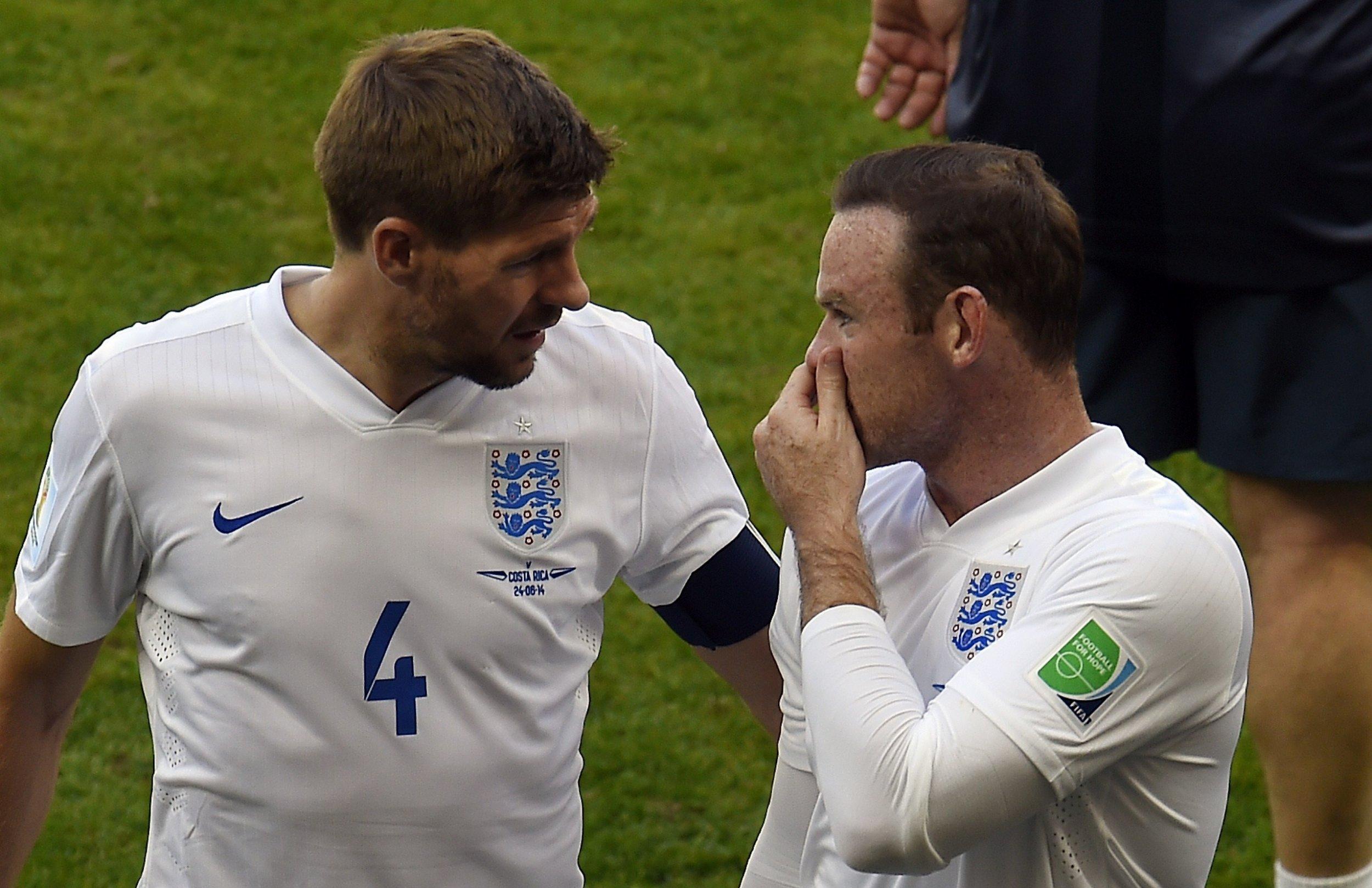 Former England captain Steven Gerrard, left, with Wayne Rooney.