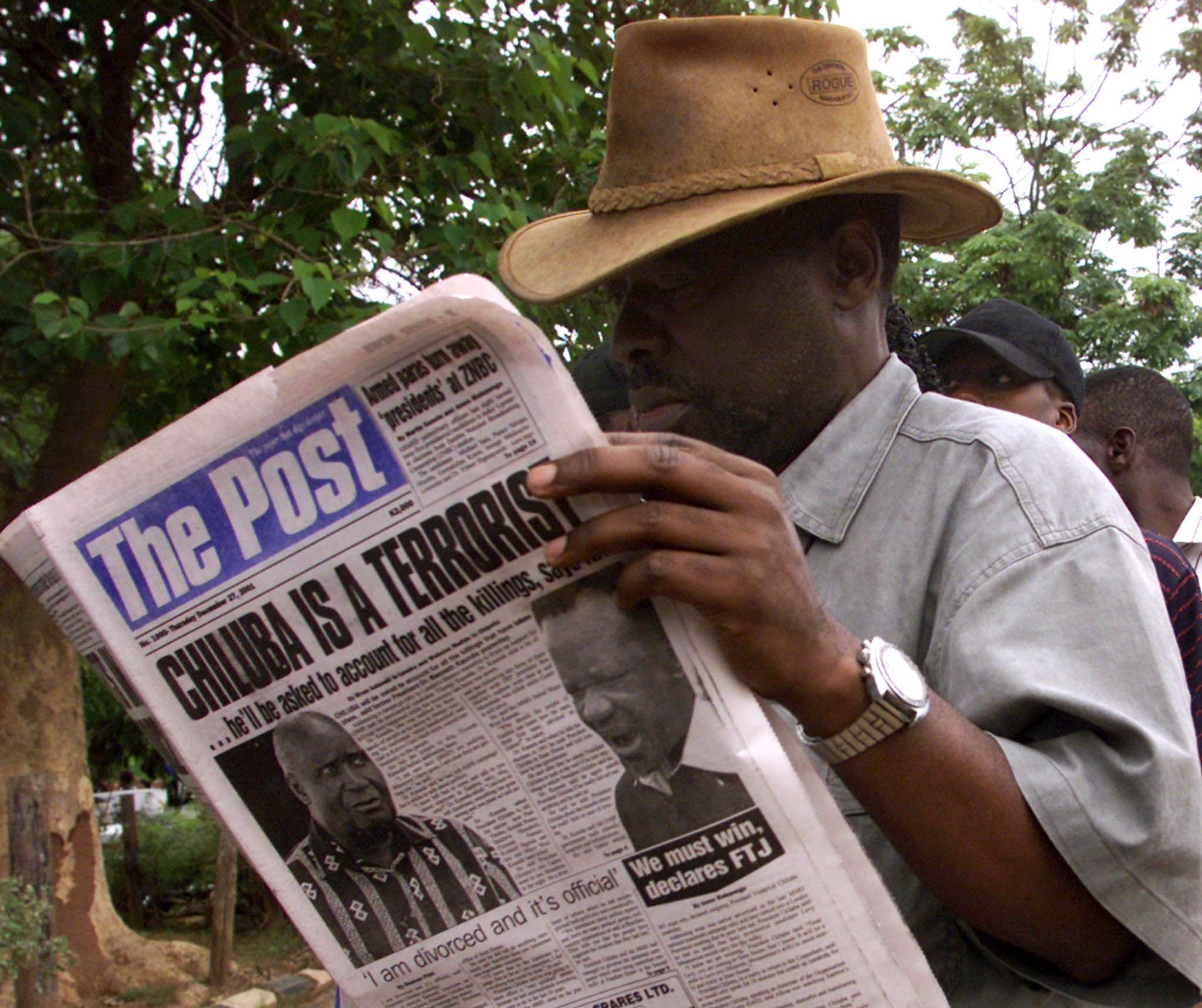 Zambian man reads The Post