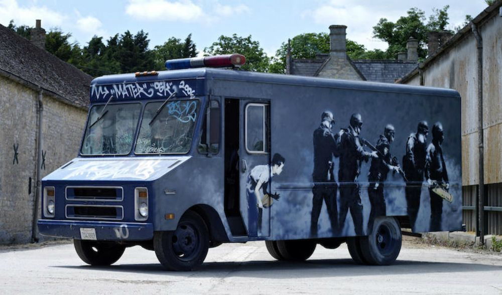 Rare banksy swat van mural sells for 218 000 for Banksy mural sold