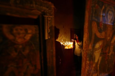 Christian lights candle in Sinai monastery