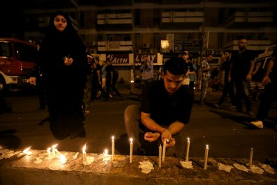 Iraqis light candles after Baghdad bombing