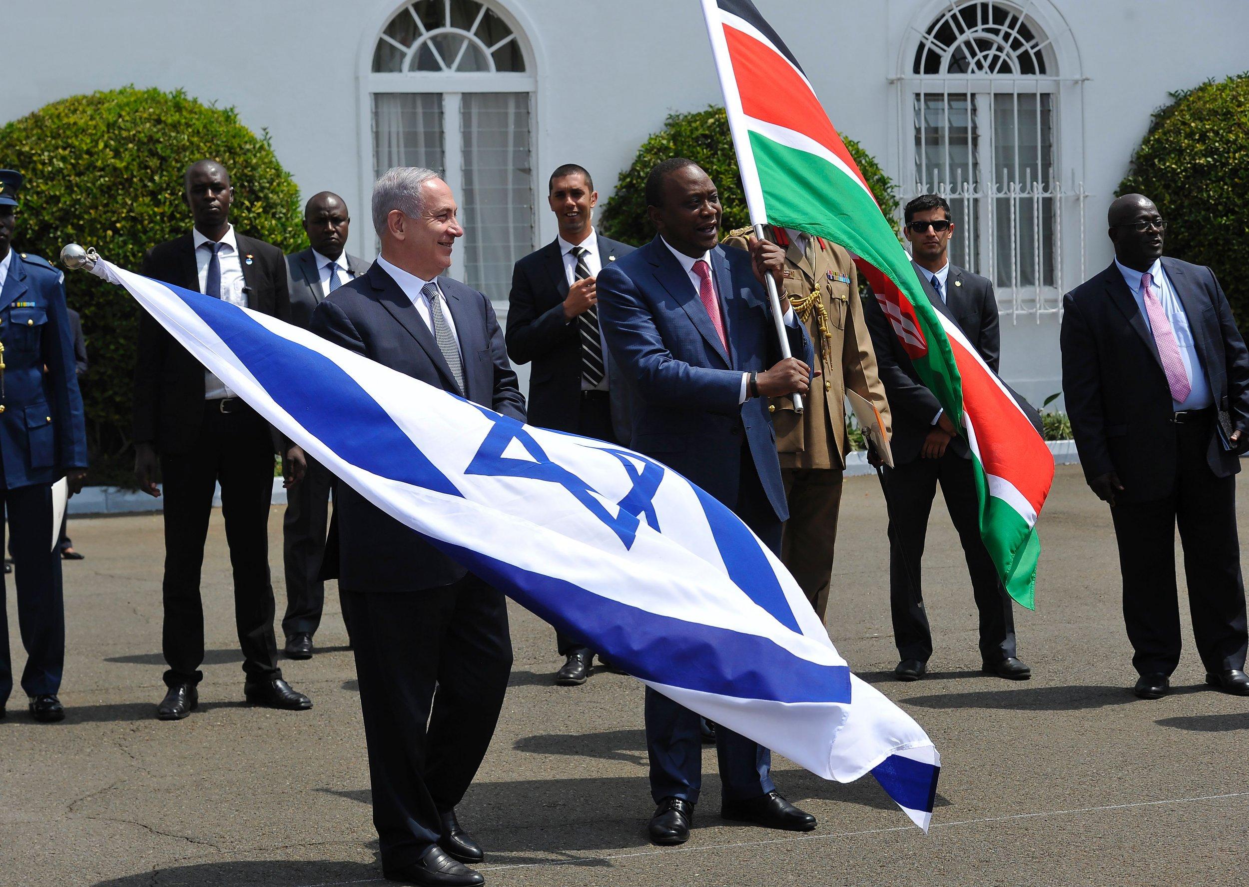 Benjamin Netanyahu and Uhuru Kenyatta wave flags